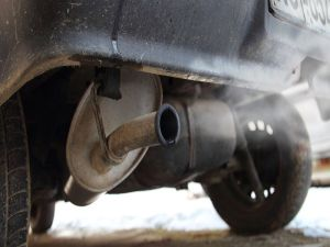 exhaust pipe of an old red car